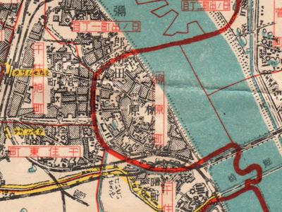 赤い区境に沿って青い川が描かれている(「大東京全圖・東部方面」報知新聞社・昭和7年)