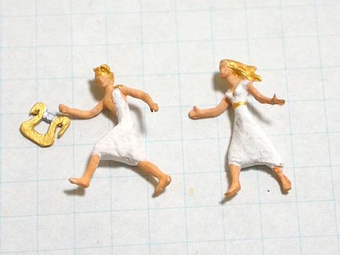 妻エウリュディケの手を引いて走る、琴の名手オルフェウス。