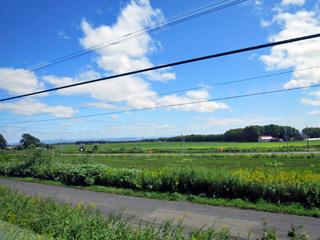 景色はほぼ広大な農村地帯に変わり