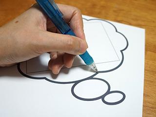 より妄想チックにしたフキダシを出力し、厚紙に当てて下絵を描く。