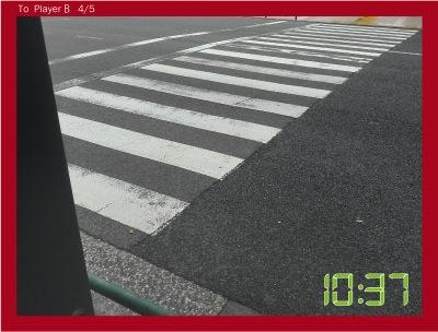 4枚目の写真として、きだてさんが通ったはずのミッドタウン前の横断歩道を送る。近くにいるという合図だ。