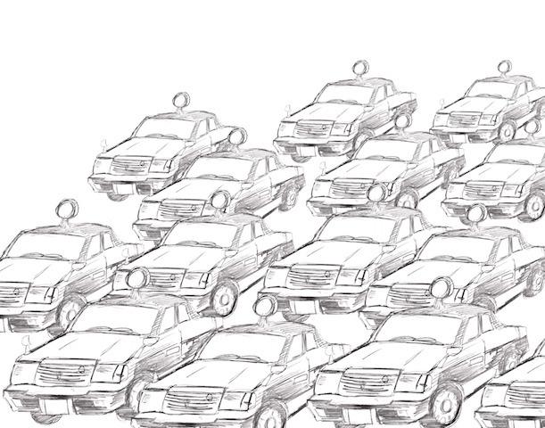 大量の黒いタクシーが通りすぎていく。