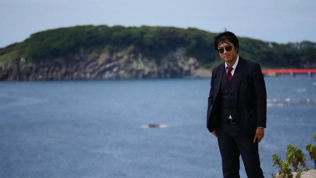 雄島をバックに記念撮影