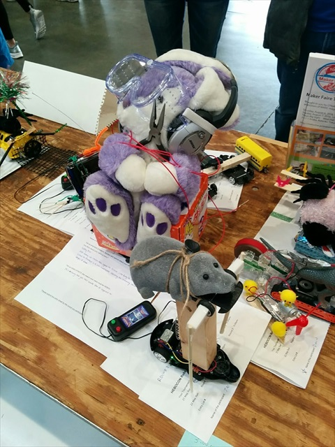 The purple rabbit is sitting on top of a box that we packaged the audio equipment in. The participants were so eager that anything valuable had to be hidden lest it be commandeered as material.