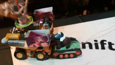 Although it lost the head of rider, Giant God Warrior was powerful enough with the caterpillar tractor's horse power (also with a horse on top) to push back the dance robot to the edge of arena.