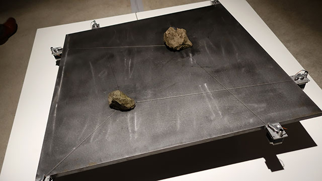 Stones sliding on top of a diagonal board