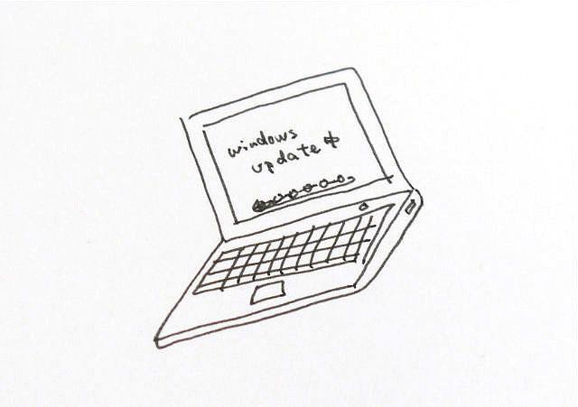 林さんのノートパソコン。Windowsアップデート中だ。