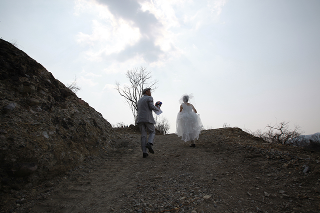 The road is flattened by a heavy machine, but this is not where to climb up with a wedding dress.