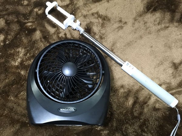 ...will receive this somewhat large portable fan attachment. I bought one that looked like it packs a punch, using four D size batteries.