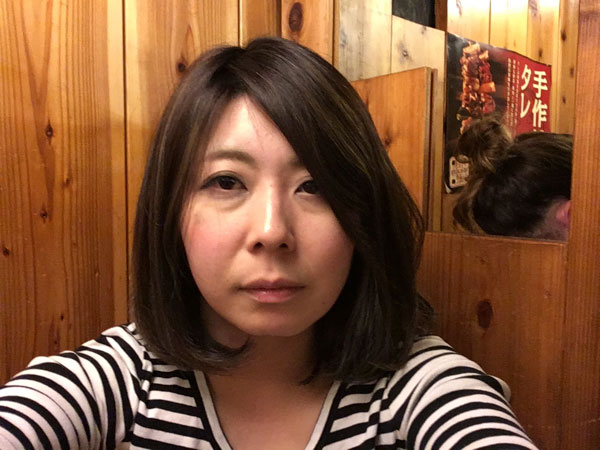 This is Mrs. Hinishi in her normal state. Her hair flows down calmly.