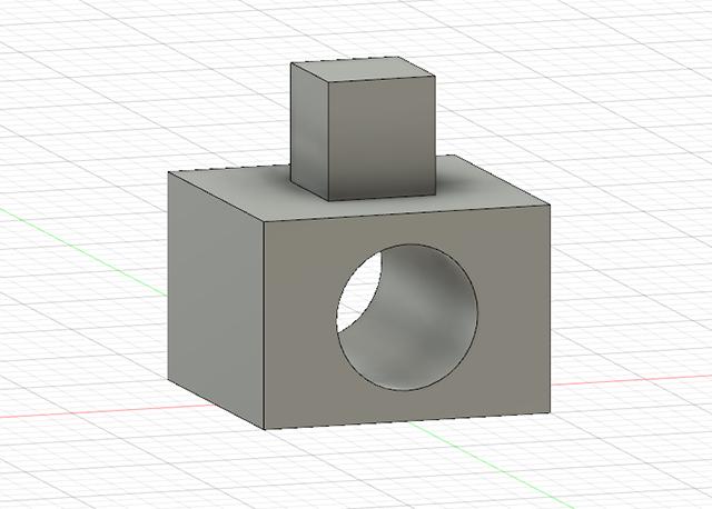 直方体の面に円を描いて押し出して穴を開け、上に四角を描いて押し出してみた感じ。